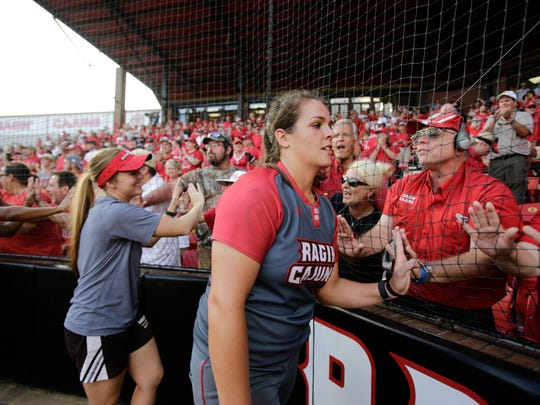 UL pitcher Alex Stewart greets fans after the Cajuns' 9-8 victory over Texas A&M in the championship game Sunday.