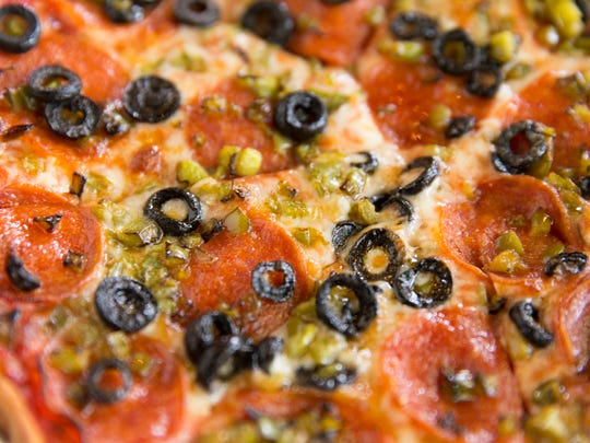 Pepperoni, olive and caper pizza at Alesi Pizza House.