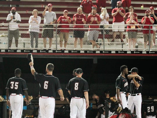 Ragin' Cajuns' Nick Thurman, #6, tips his hat to fans as they applaud the team after their 3-1 loss to the Arizona Wildcats in the NCAA Baseball Lafayette Regional championship at Tigue Field Monday.
