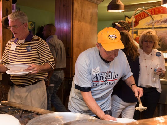 Supporters of Scott Angelle, republican candidate for Congress in the Third District, serve themselves food at a dinner/dance in Hathaway June 8, 2016.