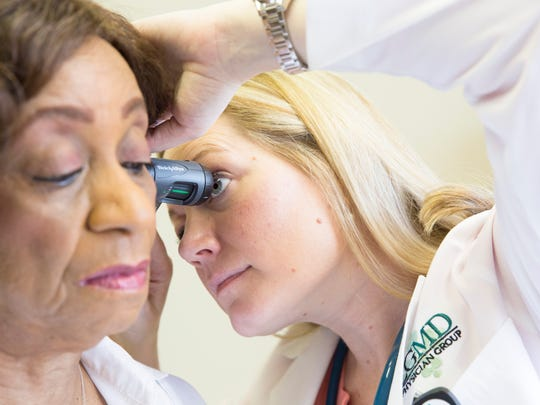 Dr. Leslie Sizmore examines Barbara Salters at Lafayette General Hospital Southwest June 8, 2016.