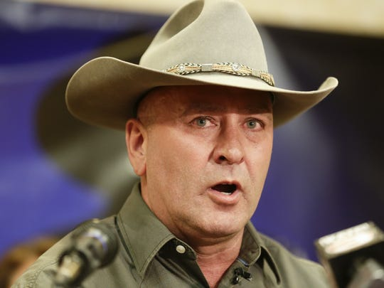 Clay Higgins speaks during a press conference announcing his candidacy as a  republican in the third congressional district in Lafayette on May 18.