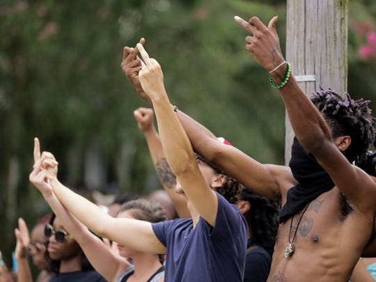 Men give the finger to police during a stand-off  on