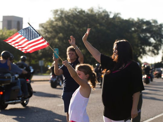 Well-wishers greet bikers traveling up Airline Highway