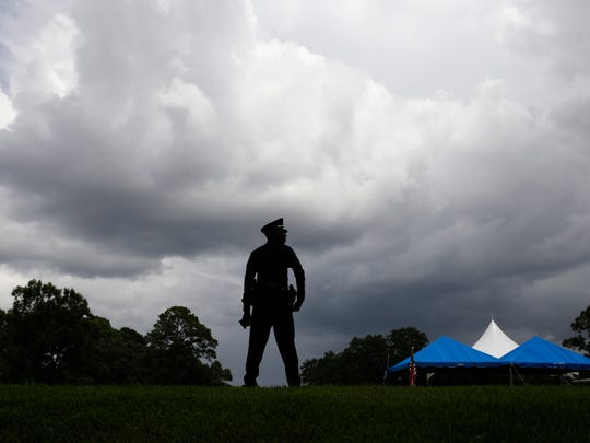 A police officer stands watch Monday before the internment ceremony of Cpl. Montrell Jackson, one of three Baton Rouge law enforcement officers killed in a July 17 shootout, in Baton Rouge.