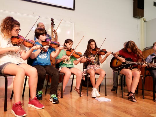 The finale of the Louisiana Folk Roots Kids Camp performed