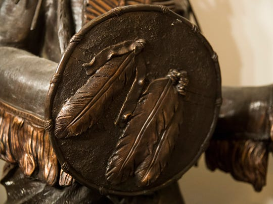 The shield of Charlie DeVille's American Indian statue in his bedroom at his Broadmoor home August 2, 2016.