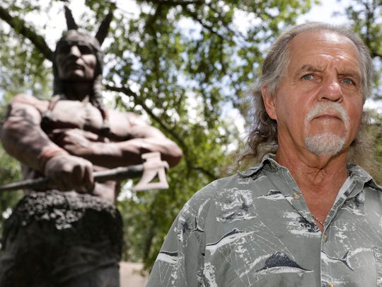 Charlie DeVille and his American Indian statue in front of his Broadmoor home August 2, 2016.