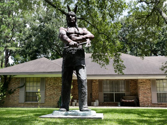 Charlie DeVille's American Indian statue in front of his Broadmoor home August 2, 2016.