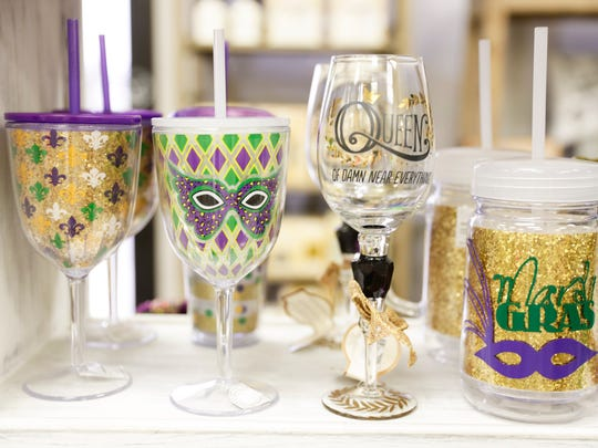 A Mardi Gras themed cups and glassware on sale at Neighbors