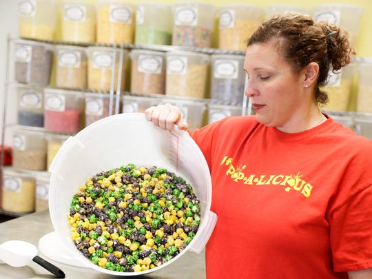 Owner Jeán Prejean with a tub of king cake flavored