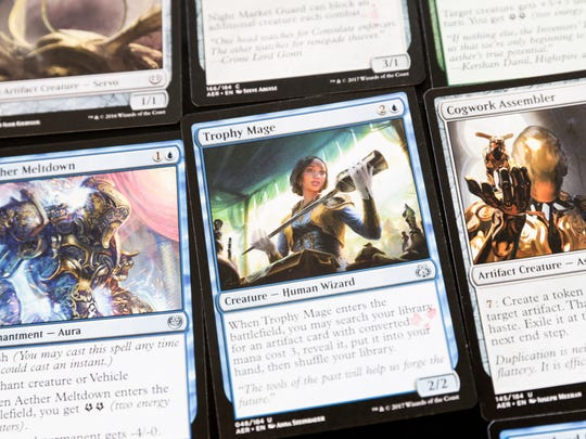Characters are printed on cards from the game Magic Wednesday, Feb. 15, 2017.