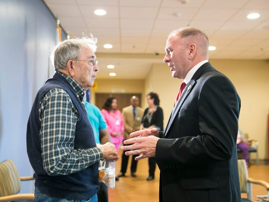 Congressman Clay Higgins, R-Port Barre, speaks with veteran Jeffery Meaux as he visits the VA's Lafayette Clinic Tuesday, Feb. 21, 2017.
