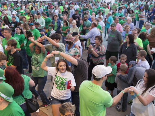 Dancers enjoy Wayne Toups during the Patty in the Parc concert celebrating St. Patrick's Day at Parc International in Lafayette March 17, 2016.