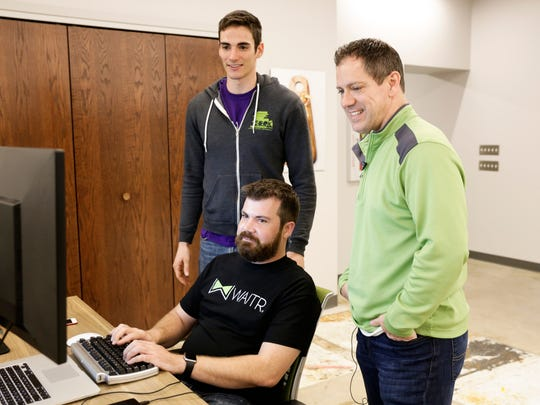 Waitr partners Adam Murnane (seated), Chris Meaux (right) and Evan Diaz de Arce work in the Lafayette office March 20, 2017.