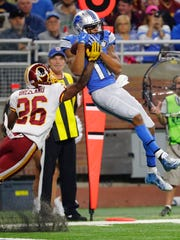 Lions receiver Marvin Jones makes a catch against Washington Redskins cornerback Bashaud Breeland during the second half Sunday, Oct. 23, 2016 in Detroit.