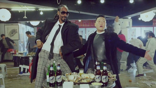 Rapper Snoop Dogg and K-pop sensation Psy teamed on the YouTube hit 'Hangover,' the type of genre-hopping collaboration increasingly favored by multicultural fans.