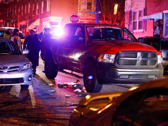 A pickup truck rests on the 1200 block of Linden Street after a child was struck and trapped underneath it about 5:45 pm Tuesday.