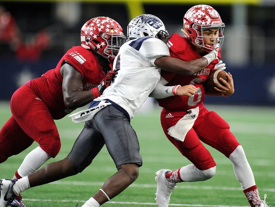 Sweetwater quarterback Chris Thompson (6) gets tackled