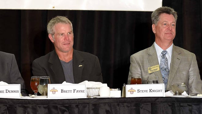 Brett Favre (left) and Steve Knight listen to the speaker at the Mississippi Sports Hall of Fame induction ceremony Saturday at the Jackson Convention Center.