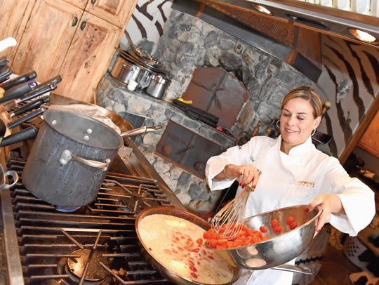 Chef Cat Cora prepares entrees during the Sundance