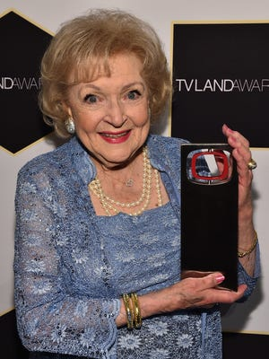 Actress Betty White poses backstage with the Legend Award during the 2015 TV Land Awards at Saban Theatre on April 11, 2015 in Beverly Hills, California.