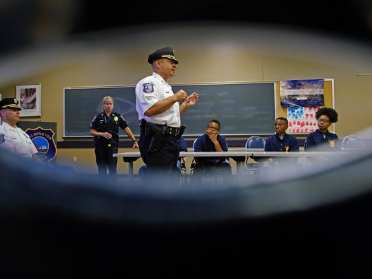 Wilmington Police Capt. William McGillian talks about his job and the role he plays in law enforcement while addressing a group of 14 teens participating in a two week Wilmington Department of Police Youth Academy camp.