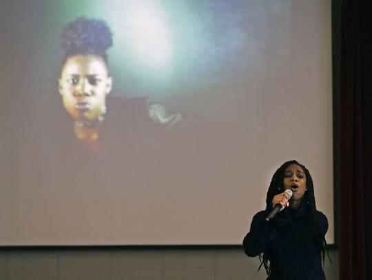 Artist Madisyn Elise of Atlanta performs Saturday during