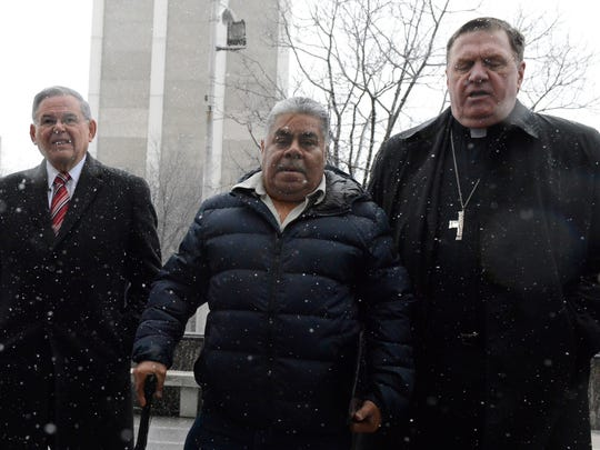 Sen. Bob Menendez and Cardinal Joseph Tobin lead ing Union City resident Catalino Guerrero to the U.S. Immigration and Customs Enforcement building in Newark on Friday.