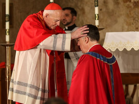 Cardinal Theodore E. McCarrick, archbishop emeritus of Washington, D.C., lays hands on the Most Rev. James Francis Checchio at his Episcopal Ordination and Installation as the fifth Bishop of Metuchen, New Jersey, at the Church of the Sacred Heart in South Plainfield, New Jersey, on May 3, 2016.