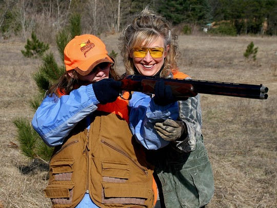 Christine Thomas, dean of the College of Natural Resources at UW-Stevens Point, gives shotgun shooting tips to a beginning hunter.
