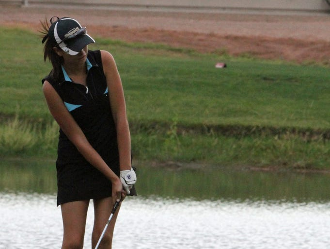 Katie Perkins chips out of a sand trap Saturday in her match against Kyla Smith. The two Desert Hills teammates competed for the championship in the Junior Association of Golf Match Play event at Sunbrook Golf Club.