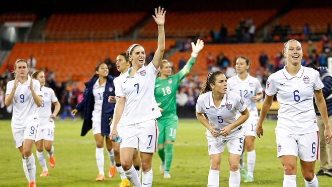 United States players wave to fans in the stands after their game against Haiti in a Women's World Cup Qualifier.