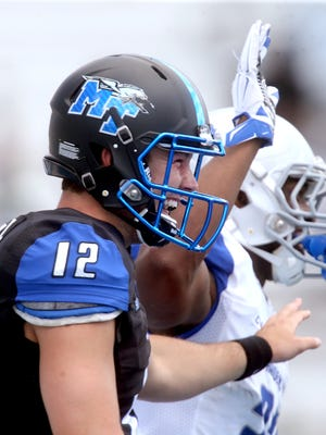 MTSU quarterback Brent Stockstill (12) leads one of the most talked about offenses in Conference USA heading into this season.