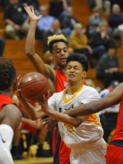 Golden West guard Jason Pascua gets fouled against Sanger in Wednesday's quarterfinal game at the 66th Polly Wilhelmsen Invitational at Mt Whitney High School.