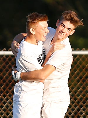 Blake Ortner, left, celebrates with teammate Joaquin Gallo after his goal with 21:42 remaining put Central Catholic up 3-2 over North White in the Class 1A soccer sectional championship Monday, October 9, 2017, at Rossville. CC defeated North White 3-2.