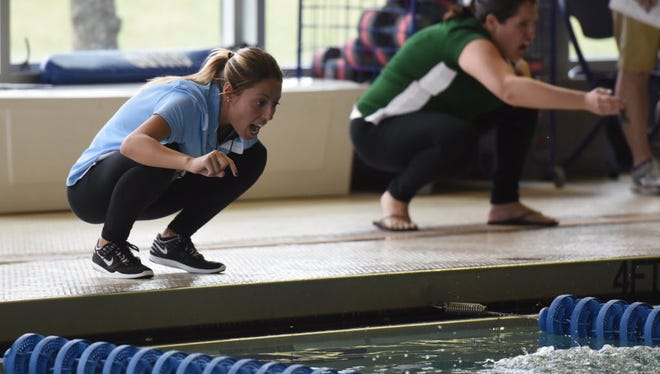 Wayne Valley girls swimming coach Sarah Kauffman (left) has been a part of both sides of the crosstown rivalry.