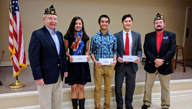 Shown are Oratorical winners with Commander from left to right: Ken Dansbury, Post 109 Youth Affairs Chairman; Rachel Tellano, second place; Ken Nguyen, third place, Zach Tellano, first place; and American Legion Post 109 Commander James Fulghum.