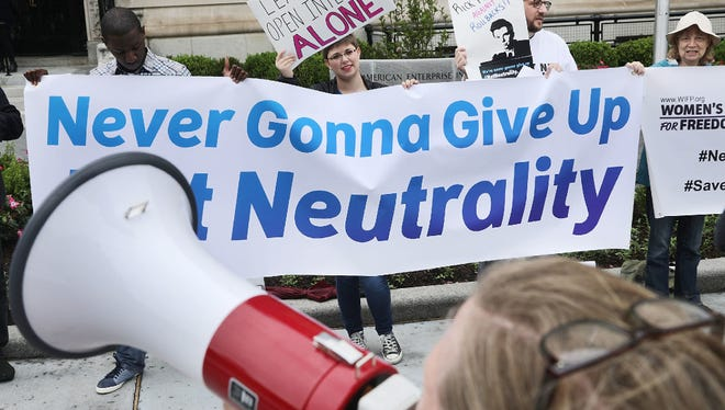 Proponents of net neutrality protest against Federal Communication Commission Chairman Ajit Pai outside the American Enterprise Institute before his arrival May 5, 2017 in Washington, DC.