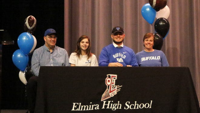 Dan Fedor with his parents, Kirk and Joan Fedor, and his sister, Megan, at a signing ceremony at Elmira High School on Feb. 8 to recognize Fedor's decision to play football at the University at Buffalo.