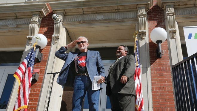 Apollo 11 astronaut Buzz Aldrin, left, salutes the crowd during the dedication ceremony of the Buzz Aldrin Middle School in Montclair on Sept. 16. The school will be the site of the upcoming  Innovation Faire.