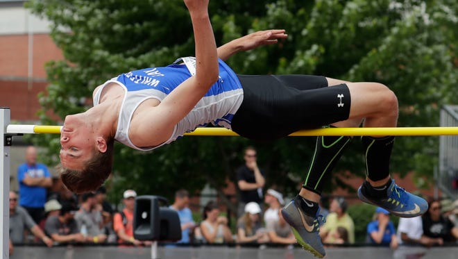 Nolan Wollmer of Whitefish Bay win the boys Division 1 high jump with an effor  of 6 feet 4 inches on Friday.