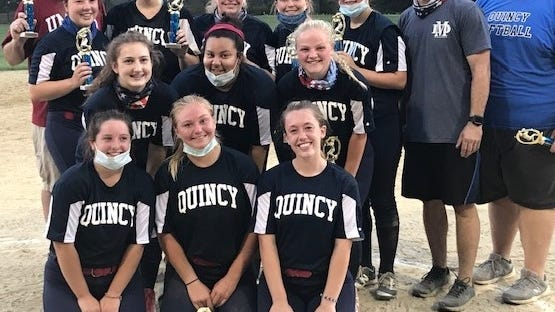 Members of the Quincy Blue team pose with their trophies after winning the South Shore Softball League 18U North crown on Wednesday night with an 18-9 victory over Canton at Mitchell/McCoy Field in Quincy. Staff photo
