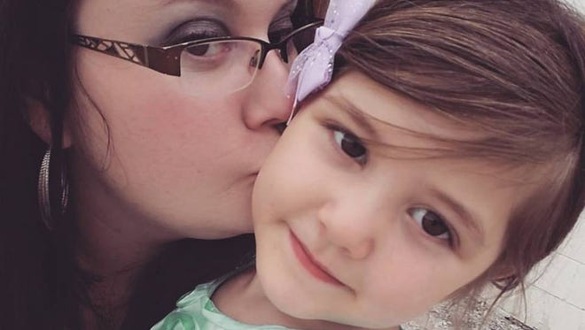 Courtney Jayne is shown with her daughter, Maggie Zaiger. Maggie drowned in Falls Park on Sunday.