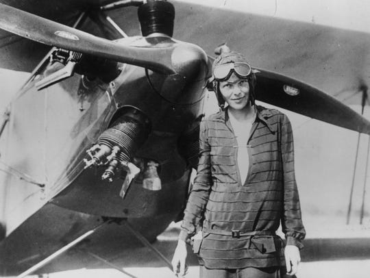 "Amelia Earhart  in front of her bi-plane called ""Friendship"""
