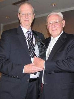 """EMS Council of New Jersey President Howard Meyer, left, presents William """"Bill"""" Madden of Freehold with the council's Lifetime Achievement Award."""