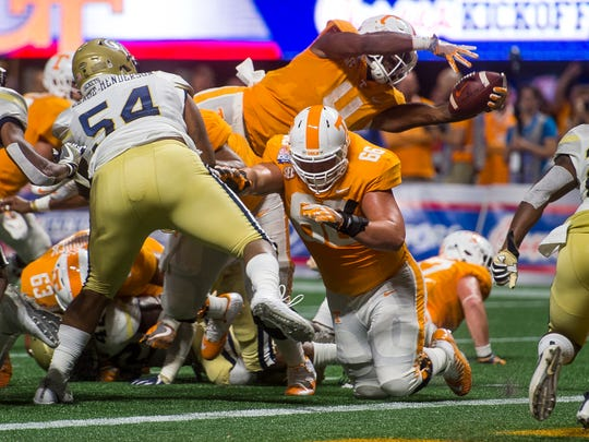 Tennessee running back John Kelly (4) leaps into the end zone during the Chick-fil-A Kickoff Game at the Mercedes-Benz Stadium in Atlanta on Monday, Sept. 4, 2017.