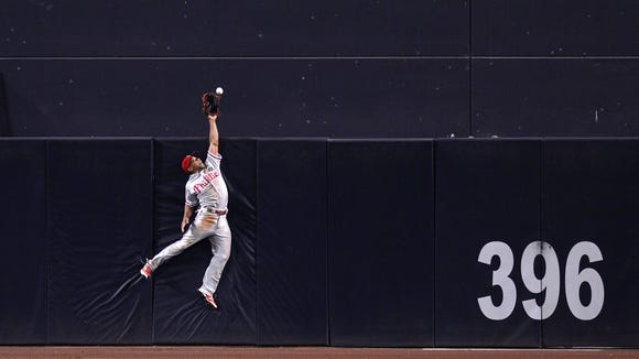 Philadelphia Phillies center fielder Ben Revere (2) cannot get to a home run by San Diego Padres right fielder Will Venable (not pictured) during the eighth inning Sept. 18 at Petco Park. Credit: Jake Roth-USA TODAY Sports