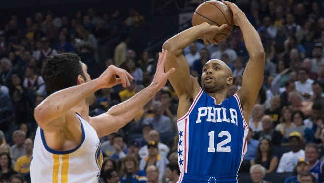 Philadelphia 76ers guard Gerald Henderson (12) shoots the basketball against Golden State Warriors center Zaza Pachulia (27) during the first quarter at Oracle Arena.