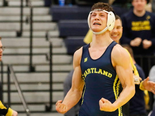 Hartland's River Shettler celebrates winning the 160-pound